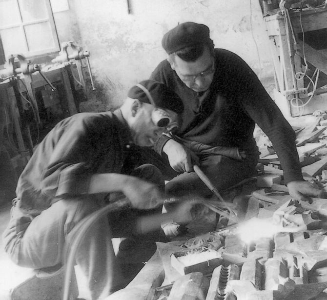The Oxy-acetylene welding of some bronze parts in the Ferdinando Marinelli Artistic Foundry of Florence (FAFM) in 1950s.